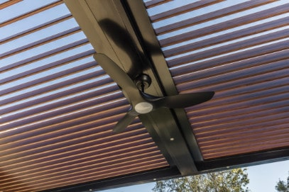 Outdoor ceiling fan installed in opening roof.